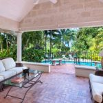 This gracious residence is located on the sixth green of Barbados' prestigious Sandy Lane Golf course, amidst 1.3 acres of beautiful tropical gardens with magnificent trees. Lot 128 is a preferred site within the Sandy Lane Estate. Offered for sale, this Villa is just 5 minutes from its own private cabana on renowned Sandy Lane Beach. Serenade comprises a large air-conditioned master suite with 'his and hers' bathrooms plus another air-conditioned, en suite bedroom strategically placed to capture the cooling trade winds. If desired, a further 2 en suite bedrooms could be provided by means of a simple extension to this bedroom wing. The main living and dining areas open onto the grounds and the 35' x 16' pool/deck and offer views of the golf course as well as tree-framed views of the sea to the West. The terraces, covered patio, gazebo and wonderful mature gardens facilitate entertaining in style and with ease. Superb modern kitchen. An inviting 2-bedroom/1 bathroom, air-conditioned guest cottage (approx 1,200 sq. ft) nestles serenely in the grounds. Serenade embodies the elegant Sandy Lane, Barbados lifestyle.